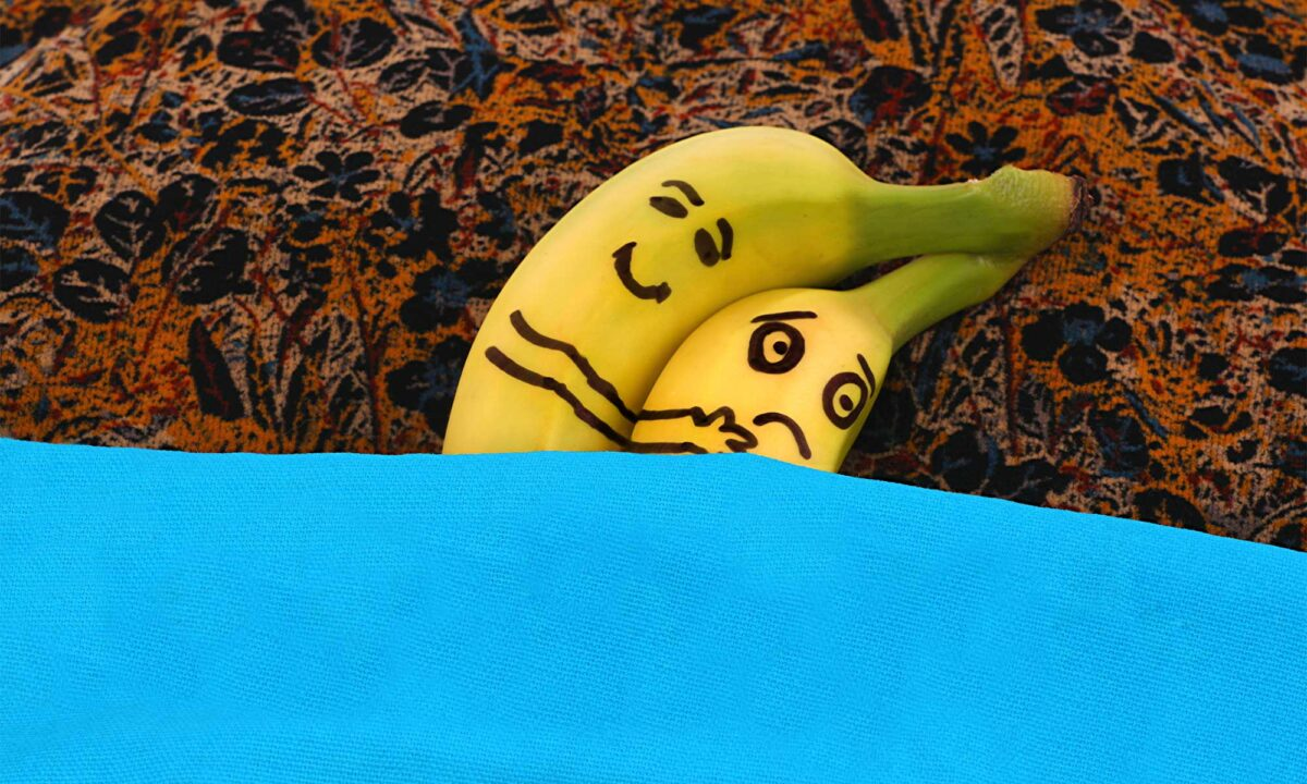 Male and female bananas in bed