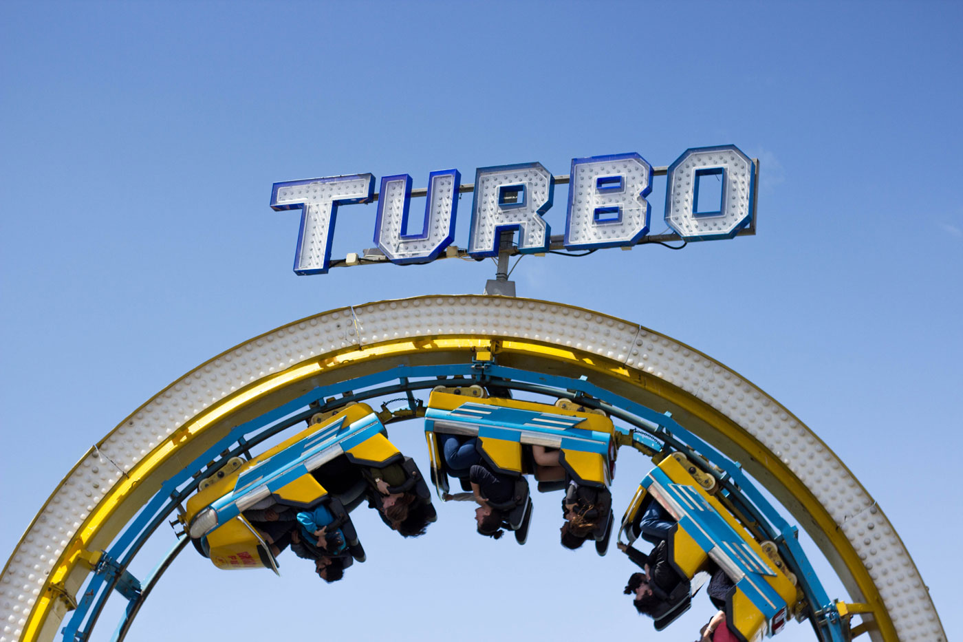 Turbo rollercoaster stopped upside down at funfair