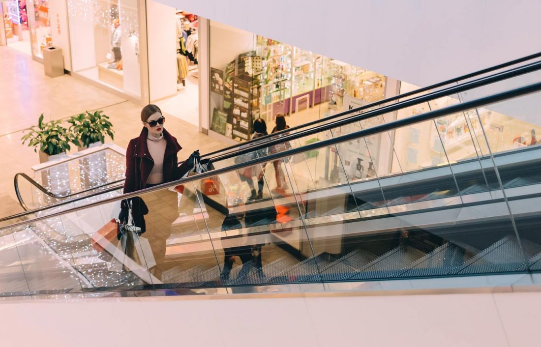 Girlfriend shopping on escalator