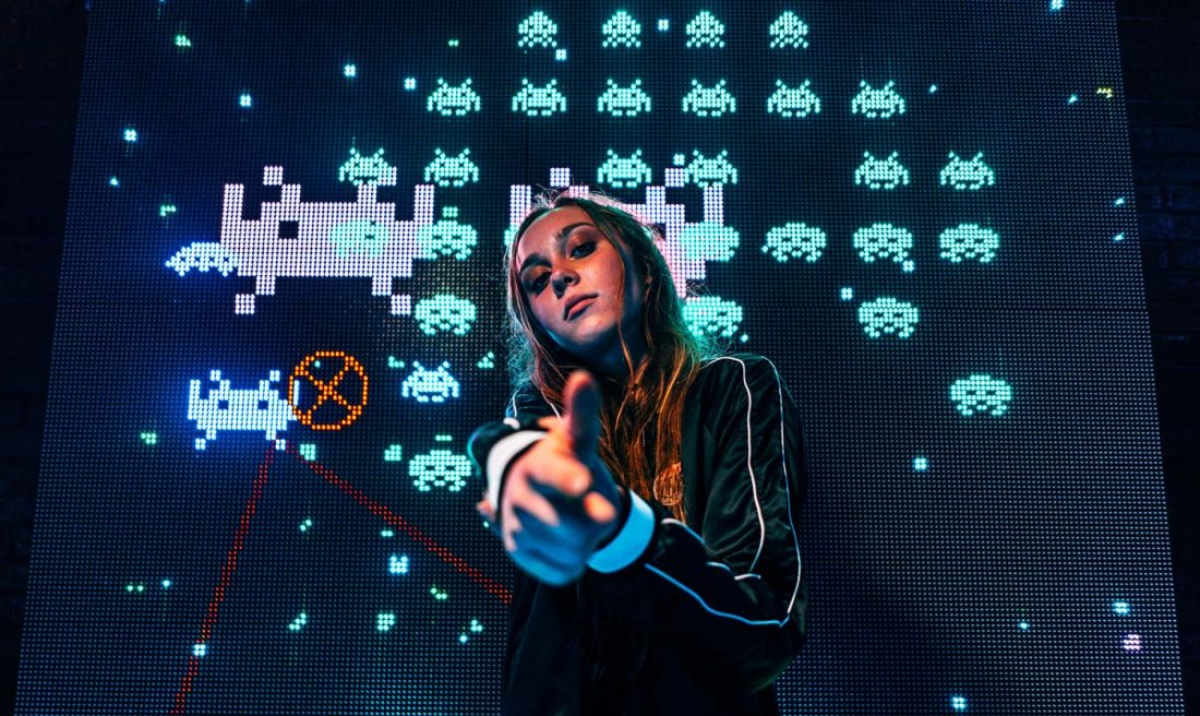 Girl with space invaders game
