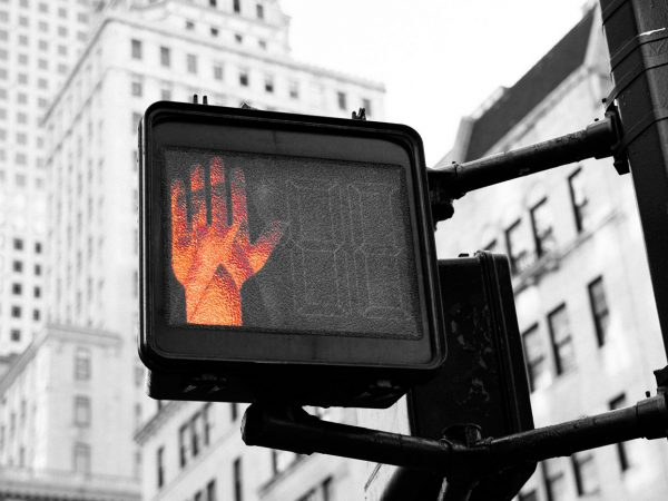 wait-sign-with-red-hand
